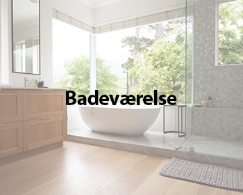 Modern bathroom interior showing free standing bath with large windows